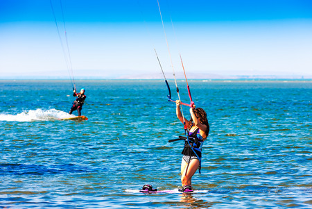 Young woman kitesurfer Editorial