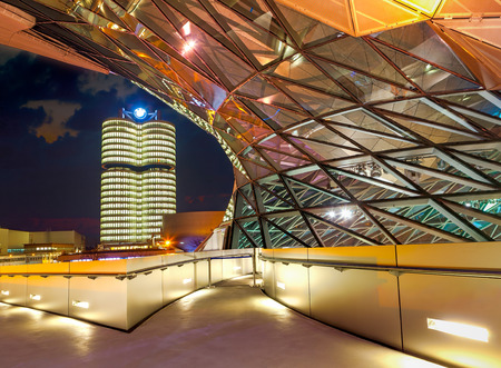 ag: MUNICH, GERMANY - MARCH 8, 2016: BMW World (BMW Welt) in Munich at night, a multi-functional customer experience and exhibition facility of the BMW AG. Editorial