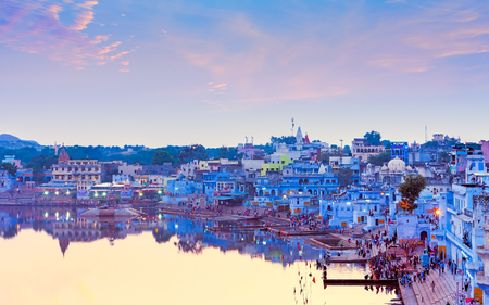 a bathing place: PUSHKAR, INDIA - NOVEMBER 21, 2012: Hindu pilgrims came to sacred Lake Pushkar (Sarovar) on ghats. Countless people in colourful attire gather to take a dip in the Holy Lake and pray to deities. Editorial