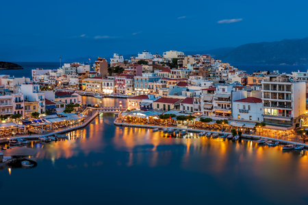 edge: Agios Nikolaos, Crete, Greece. Agios Nikolaos is a picturesque town in the eastern part of the island Crete built on the northwest side of the peaceful bay of Mirabello.
