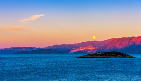 Full moon over the island of Crete at sunset, Mirabello Bay, Crete, Greece