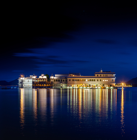 Lake Pichola and Taj Lake Palace at night , Udaipur, Rajasthan, India, Asia.  Stock Photo