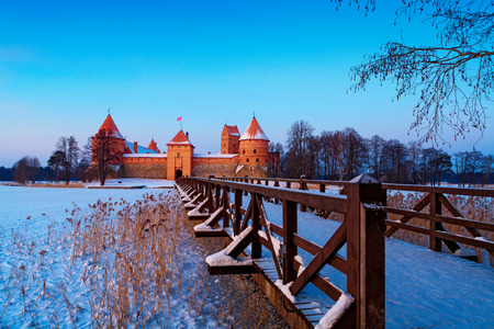 Trakai in winter. Trakai is a historic city and lake resort in Lithuania. It lies 28 km west of Vilnius, the capital of Lithuania. Editorial