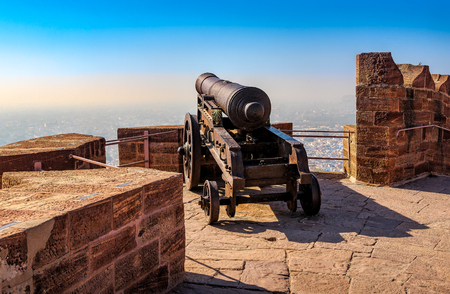 Old historical cannon on the fortress wall of Mehrangarh Fort in Jodhpur, Rajasthan, India, Asia