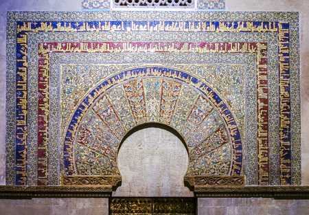 Cordoba, Andalucia, Spain - March 13, 2018:  Interior of Great Mosque of Cordoba and the Mezquita, Cathedral of Our Lady of the Assumption in Historic centre of Cordoba.