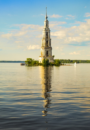 Flooded bell tower of St. Nicholas Cathedral in Kalyazin - the main landmark of the city. Kalyazin - the city of the Golden ring of Russia Stock Photo