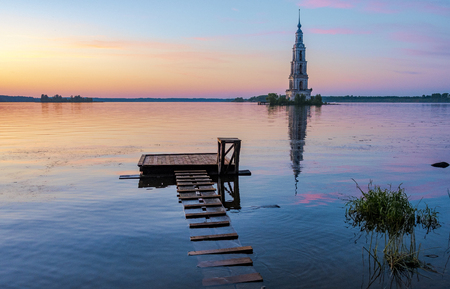 Flooded bell tower of St. Nicholas Cathedral in Kalyazin at sunset. Kalyazin - the city of the Golden ring of Russia