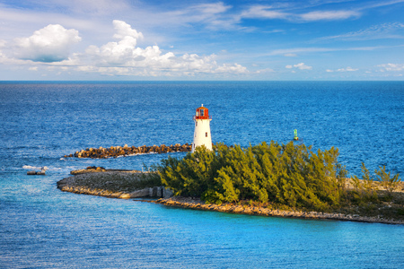 Nassau Harbour Lighthouse, Bahamas. This is billed as the oldest and best known lighthouse in The Bahamas. It is located at the western tip of Paradise Island, marking the northwest entrance to New Providence and the Port of Nassau.