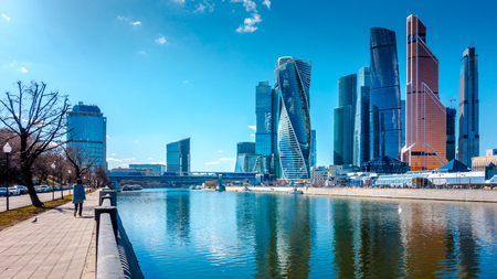 Skyscrapers Moscow International Business Center over Moscow river and Bagration bridge. Movement of people along the embankment of the river. Moscow, Russia Redakční