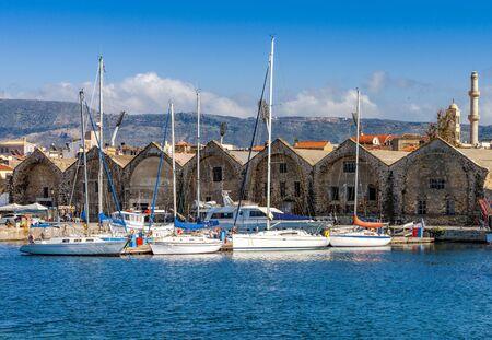 Yachts and boats moored near the Venetian Neoria, Chania, Crete, Greece.