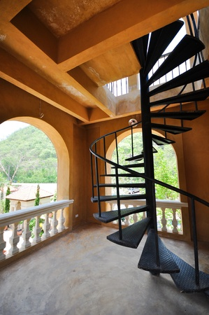 black spiral stair on terrace photo