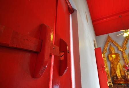 old style wood latch in thai buddhist church photo