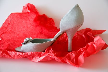 cramped: a close up of fashionable ladys shoe on a red cramped paper