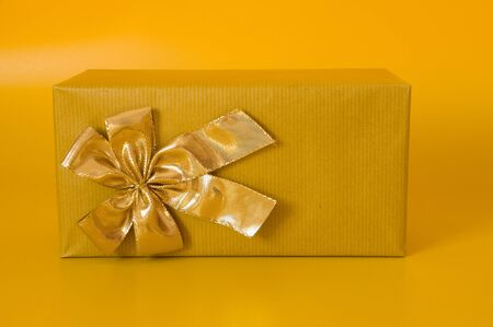 gift box with golden bow as a symbol of Christmas presents photo