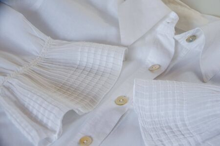 purl: detail of a white shirt with fancy cuffs and purl buttons