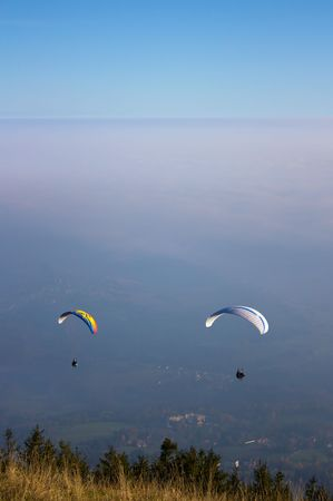 Two para-gliders flying from the Schoeckl in Styria, Austria