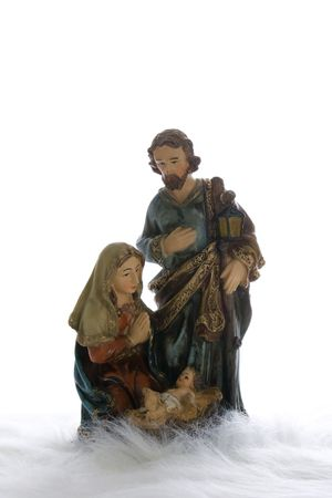 Joseph and Mary wtih Jesus child in manger