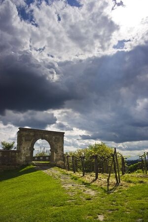 Castle gate and storm clouds