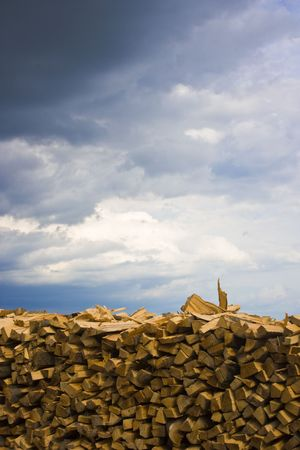 Wood pile and storm clouds