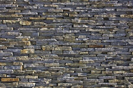 Texture wall with different rocks in grey Stock Photo