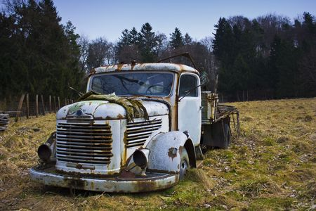 Old truck from Austria standing very long time in the field