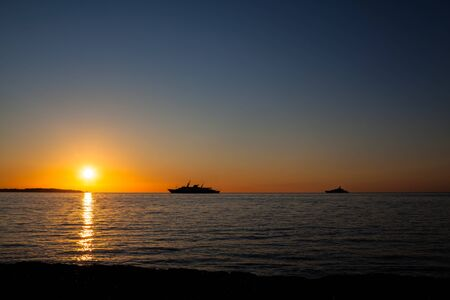 Sunrise over Cap dAntibes view from Palm Beach at Point Croisette in Cannes,  Cote dAzur, France Stock Photo