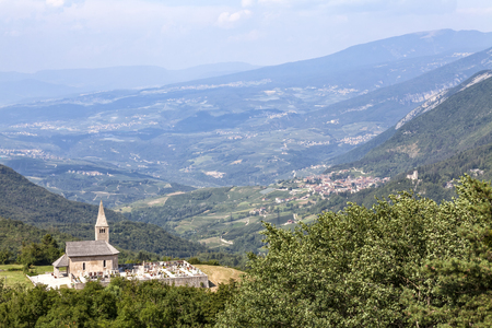 Chruch Chiesa di San Tommaso and view in valley to town Proloco in Italy, Europe