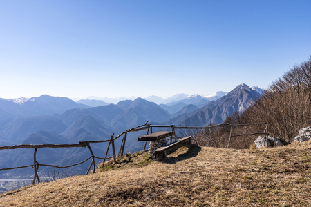 Wooden bench and table on Monte San Simeone with beautiful view to Julian Alps