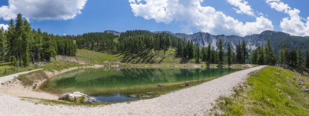 Lake on mountain Petzen with forrest and mountain Hochpetzen in the background in Carinthia, Austria