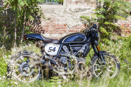 scrambler: Cool looking custom made scrambler style cafe racer parking in the meadow near an old house