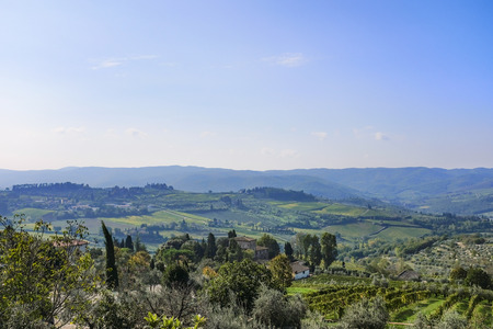 View from Castellina in Chianti to the hills with vineyards in Tuscany in Italy