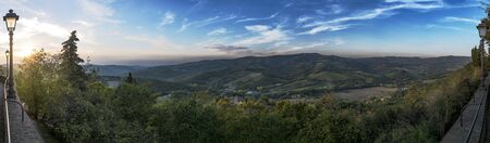 Panoramic view with sunset from town Radda in Chianti to beautiful Tuscany in Italy Stock Photo