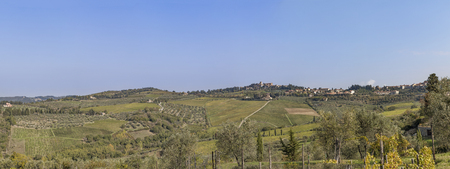 View to town Chastellina in Chianti with hills with vineyards in Tuscany in Italy Stock Photo