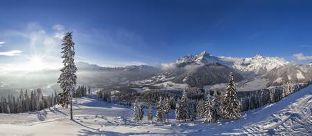 Sunset from hut on mountain in skiresort Werfenweng over winter wonderland and Tennen mountains in Salzburg, Austria Stock Photo