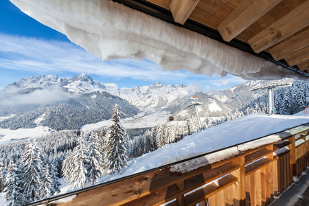 View from terrace of wooden hut on mountain in skiresort Werfenweng to Tennen mountains in Salzburg, Austria