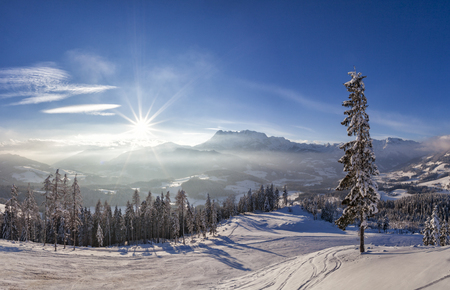 View from hut on mountain in skiresort Werfenweng to winter wonderland with sunset and Tennen mountains in Salzburg, Austria Stock Photo