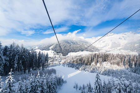 View from gondola lift to small city Werfenweng and Tennen mountains in Salzburg, Austria