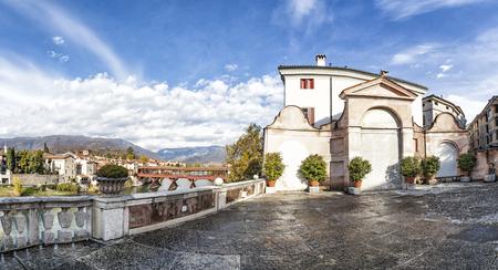 View from old terrace to bridge Ponte degli Alpini and mountain in Bassano del Grappa in Italy