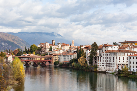 Cityscape of Bassano del Grappa with river Brenta and bridge Ponte degli Alpini in Vicenza, Italy