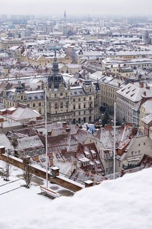 View from Schlossberg to town hall and main square in Graz with snow in winter