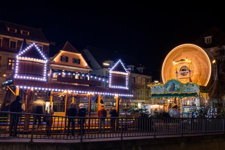 Old spinning ferris wheel on childrens christmas fair in Graz, Styria Austria