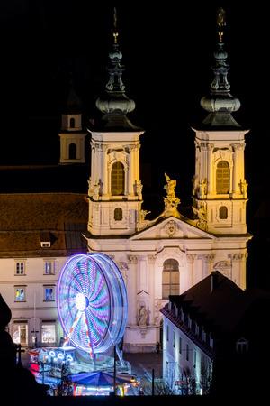 View from Schlossberg in Graz to Mariahilferplatz with church Mariahilf and christmas fair with ferris wheel