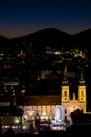 View from Schlossberg in Graz to Mariahilferplatz with church Mariahilf and christmas fair with ferris wheel