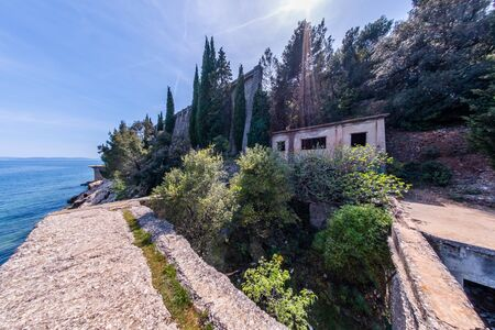 Abandoned ruined lost place port with funicular to bauxite mine in town Cere near Rabac in Istria, Croatia