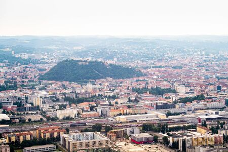 Aerial view of city Graz from helicopter drone with district Gösting and the railway station on a sunny summer day in Austria, Europe Stock Photo