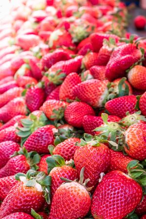 Big pile of fresh juicy red strawberries on a fruit market stall in Zagreb, Slovenia