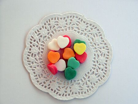 colored candy hearts on dolie        Stock Photo