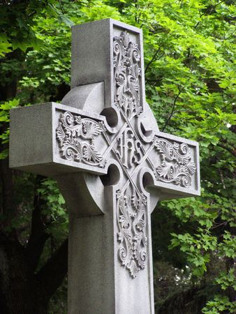 carved cross in a cemertey        Banco de Imagens