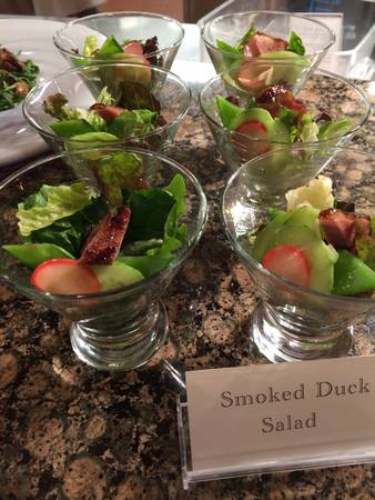 A simple salad made of Spinach and Iceberg Lettuce. The leaves are tossed very lightly in a Smoked Hickory and Basil Vinaigrette. A piece of smoked Duck cut on the bias is placed on top of the finished salad. Because of the small portion size and just to