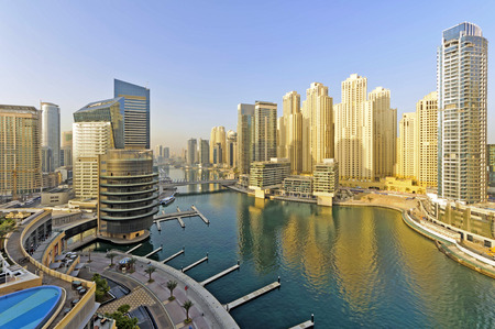 View of Dubai marina district. Dubai Marina is an artificial canal city built along a two mile 3 km stretch of Persian Gulf shoreline.  This district is in the heart of what has become known as